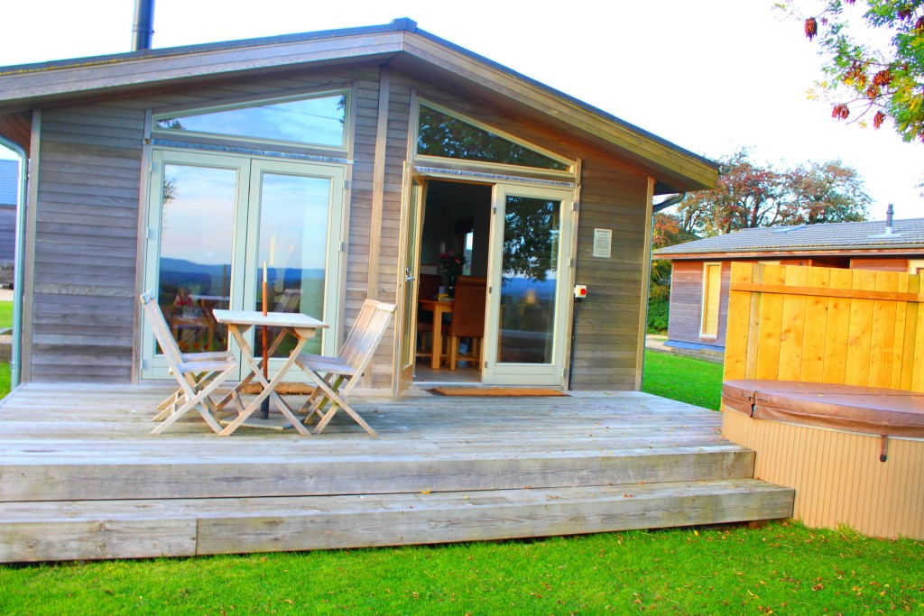blue chip holidays furrow fields lodge decking and hot tub view of the back