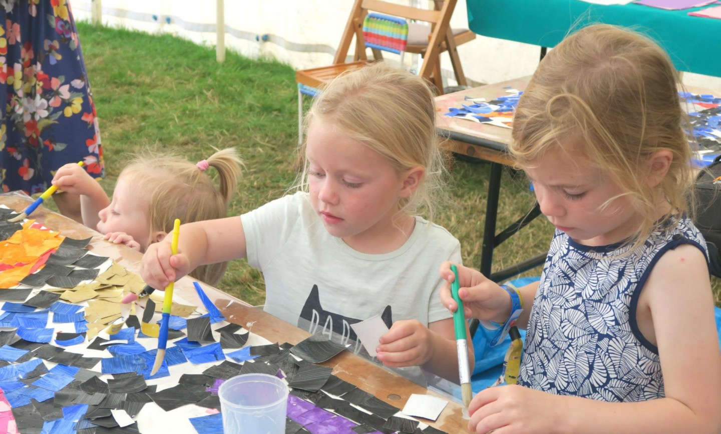 Camp Bestival kids creating in art town