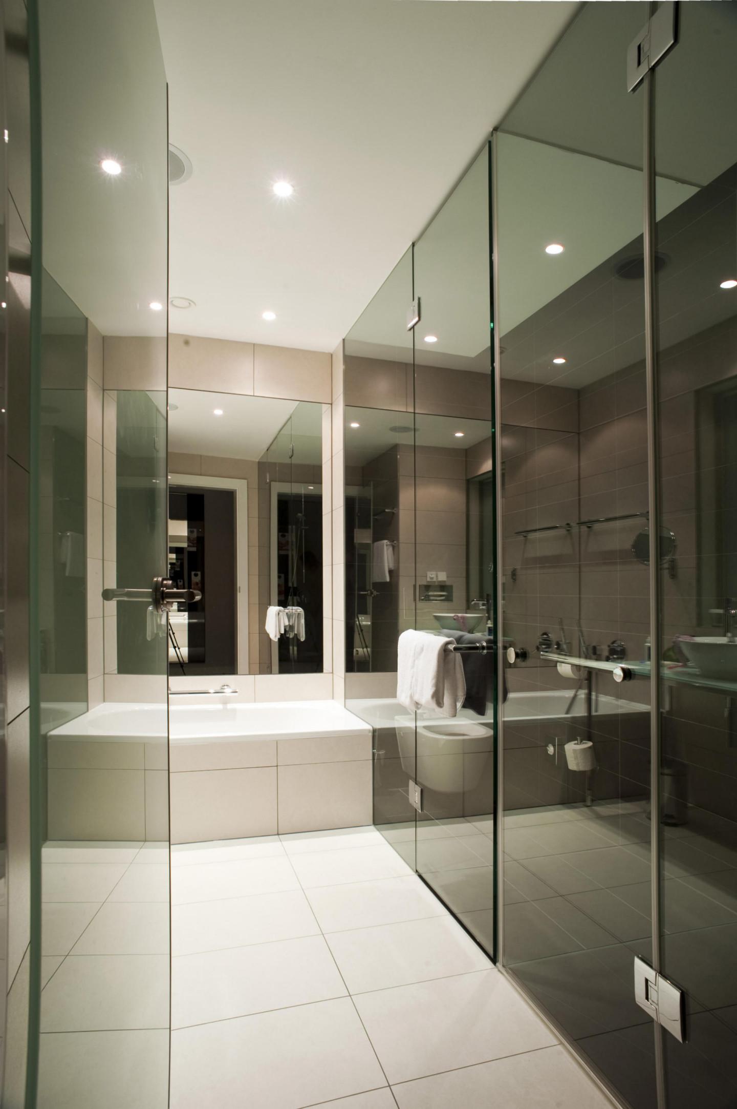 glass interior of a stylish modern hotel bathroom